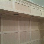 Custom wood soffit and surround over bed in master bedroom